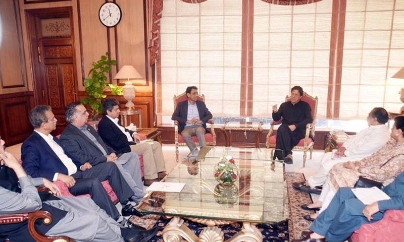 PM Khan in a meeting with MQM's top leadership — DawnNewsTV