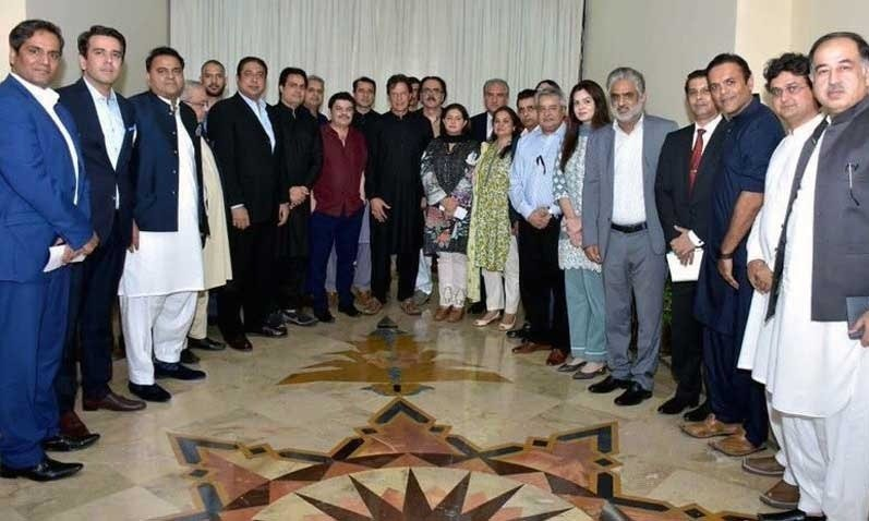 Prime Minister Imran Khan with journalists in Islamabad. — Photo Courtesy: Radio Pakistan