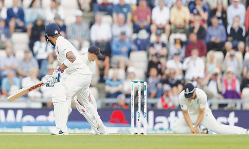 SOUTHAMPTON: Indian captain Virat Kohli looks behind to see England's Alastair Cook take his catch during the fourth Test at the Ageas Bowl on Friday.—AP