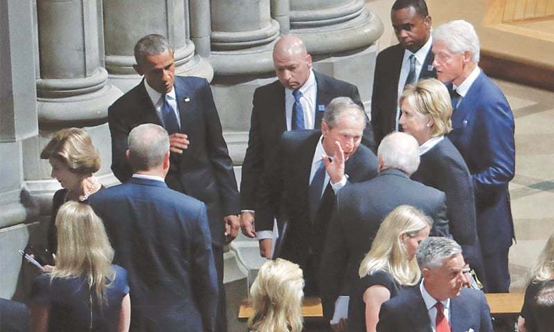Former presidents Barack Obama, George W. Bush and Bill Clinton, former vice president Dick Cheney, former secretary of state Hillary Clinton, former first lady Laura Bush and other US officials walk out after attending the memorial service for Senator John McCain at Washington National Cathedral on Saturday.—AP