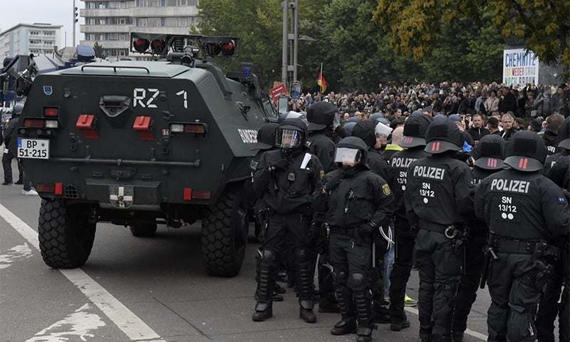 Police beside an armoured car as they separate right-wing and left-wing protesters in Chemnitz, eastern Germany, on Saturday. ─ AP