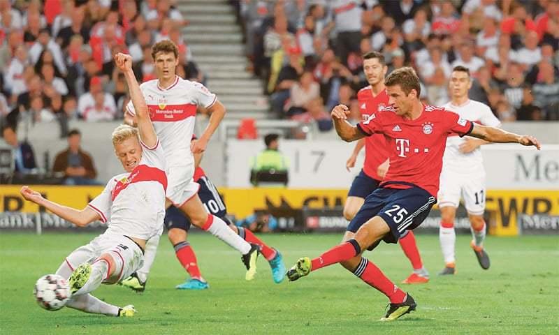 STUTTGART: Bayern Munich's Thomas Mueller shoots to score during their Bundesliga match against VfB Stuttgart at the Mercedes-Benz Arena.—Reuters