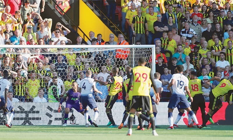 WATFORD: Watford's Troy Deeney (R) scores the first goal against Tottenham Hotspur during their English Premier League match at Vicarage Road on Sunday.—Reuters