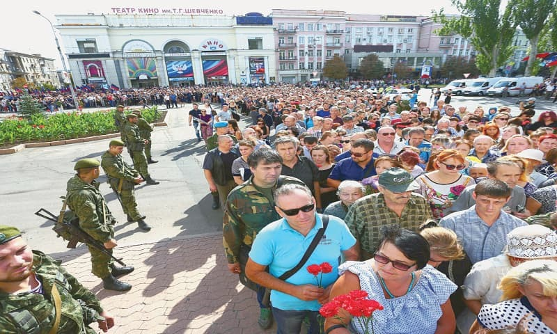 DONETSK: People attend the funeral ceremony for assassinated leader of the self-proclaimed Donetsk People's Republic Alexander Zakharchenko on Sunday.—AFP