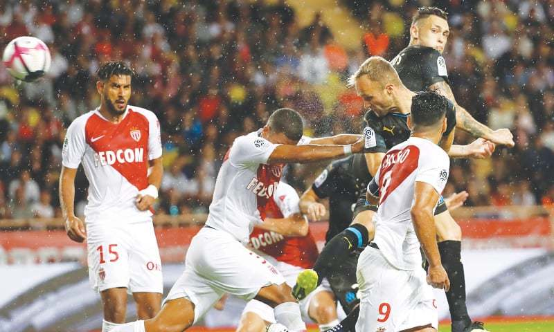 MONACO: Olympique de Marseille's Valere Germain heads to score during the Ligue 1 match against AS Monaco at Stade Louis II.—Reuters