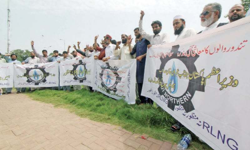 Traders protest outside the National Press Club on Wednesday against the RLNG tariff increase. — Online