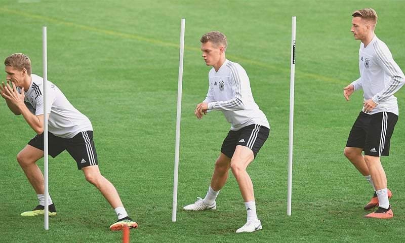 MUNICH: (L-R) Germany's Nils Petersen, Matthias Ginter and Marco Reus warm up during a training session on Wednesday.—AFP