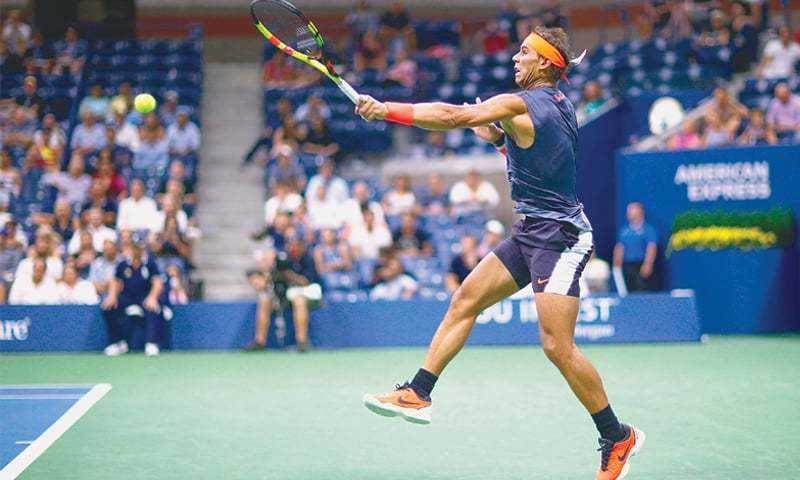 SPAIN'S Rafael Nadal returns the ball to Dominic Thiem of Austria during their US Open quarter-final at the USTA Billie Jean King National Tennis Center.—AFP