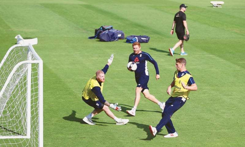 LONDON: England's Jonny Bairstow (C) plays football with Ben Stokes (L) and Jos Buttler during a training session at The Oval on Thursday, ahead of their fifth Test against India.—Reuters