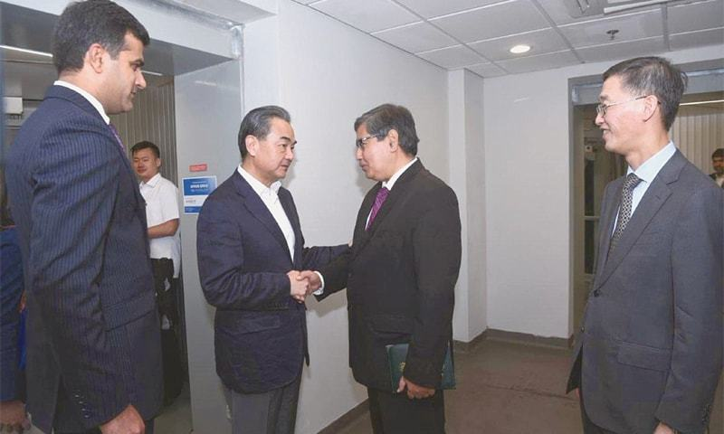 ISLAMABAD: Chinese Foreign Minister Wang Yi being received by officials of the Foreign Ministry upon his arrival on Friday.—Online
