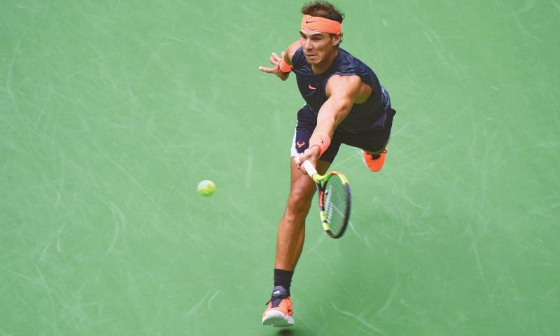 RAFAEL Nadal hits a return to Juan Martin del Potro during their aborted semi-final at the USTA Billie Jean King National Tennis Center.—AFP