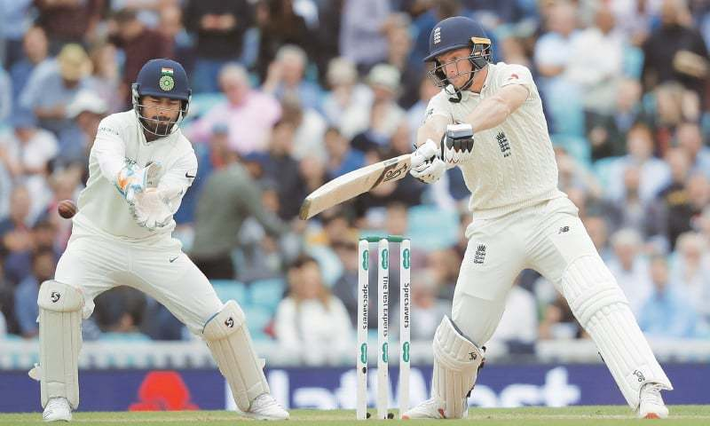 LONDON: England batsman Jos Buttler cuts as Indian wicket-keeper Rishabh Pant looks on during the fifth and final Test at The Oval on Saturday.—AP
