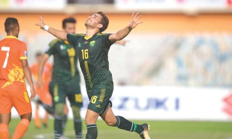 DHAKA: Pakistan's Mohammad Riaz celebrates scoring against Bhutan during their SAFF Cup Group 'A' match at the Bangabandhu National Stadium on Saturday.—Courtesy SAFF
