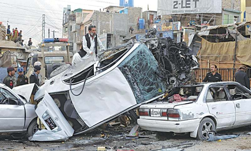 Pakistani security personnel search the wreckage of vehicles after the bomb explosion at Baccha Khan Chowk | Dawn file photo