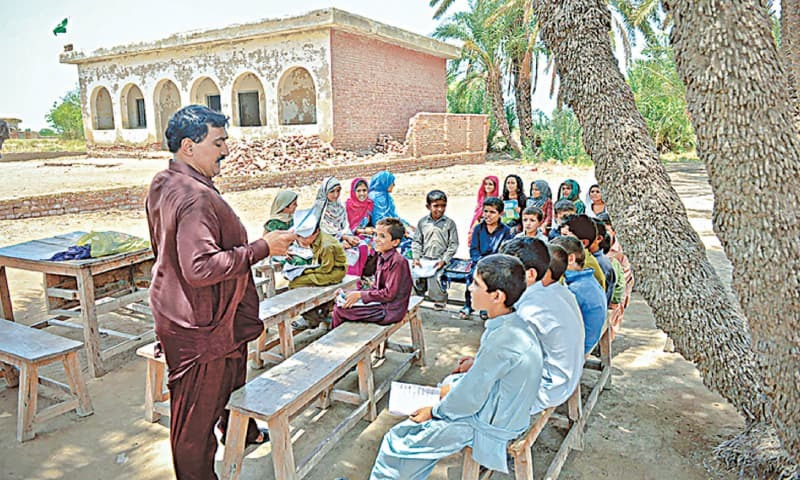 A 2014 file photo shows students outside the school as the building is considered unsafe. According to Javed Ahmed Malik, villages must have some degree of administrative autonomy in order to progress | Fahim Siddiqi/White Star
