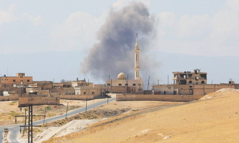 Khan Sheikhun (Idlib, Syria): Smoke billows following Syrian government forces' bombardment around the town on Saturday.—AFP