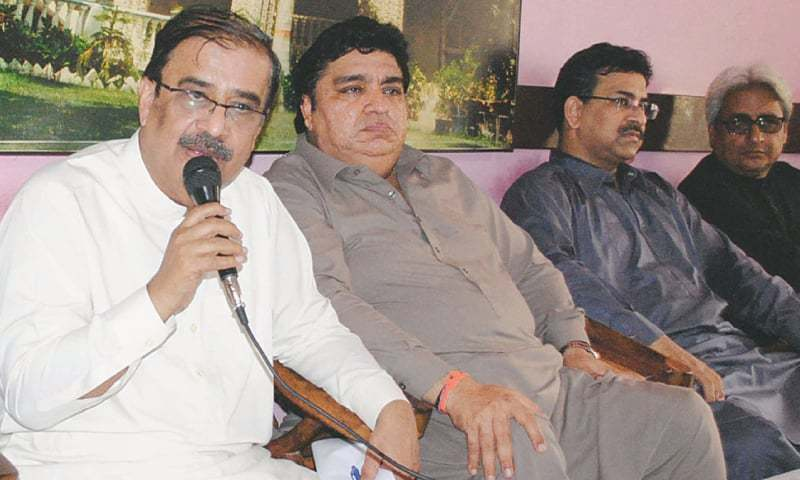 PML-N Sindh president Syed Shah Mohammad Shah speaks at the press conference on Sunday.—Dawn