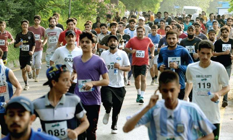 People participate in the marathon held in Islamabad on Sunday. — Photo by Mohammad Asim