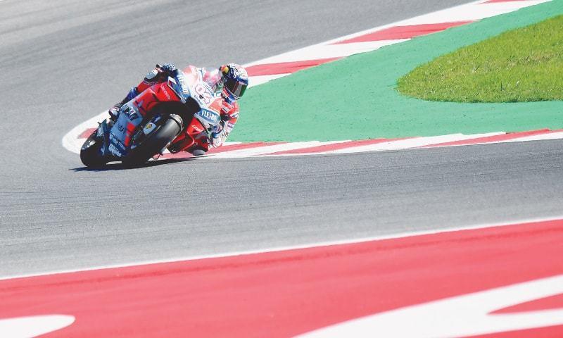 MISANO ADRIATICO: Ducati's Andrea Dovizioso leads during the San Marino MotoGP at the Marco Simoncelli Circuit on Sunday.—AFP