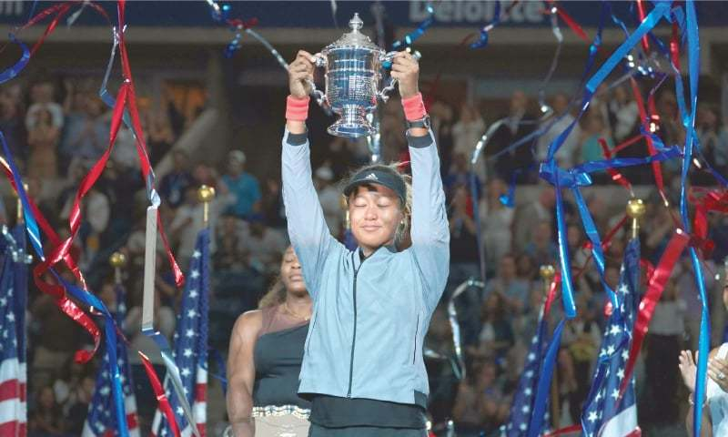 NAOMI Osaka lifts the trophy after her victory.—AFP