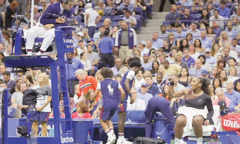 NEW YORK: Serena Williams talks to chair umpire Carlos Ramos during a changeover in the US Open final against Naomi Osaka.—AP