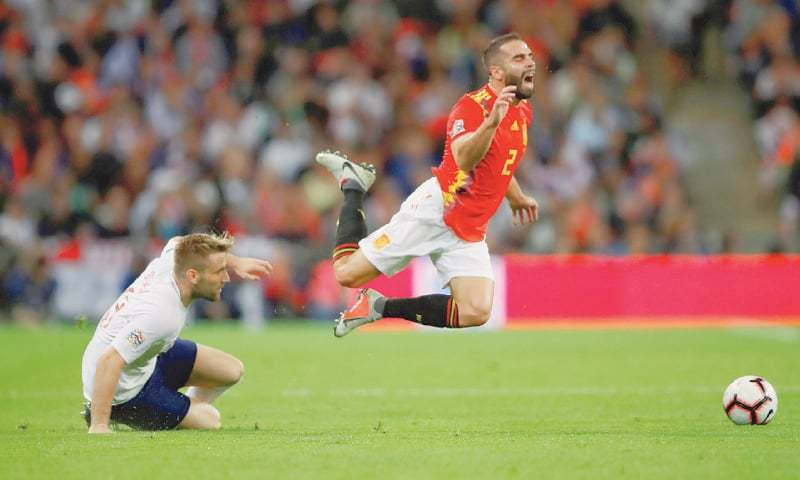LONDON: Spain's Dani Carvajal (R) is fouled by England's Luke Shaw during their UEFA Nations League match at the Wembley Stadium.—Reuters