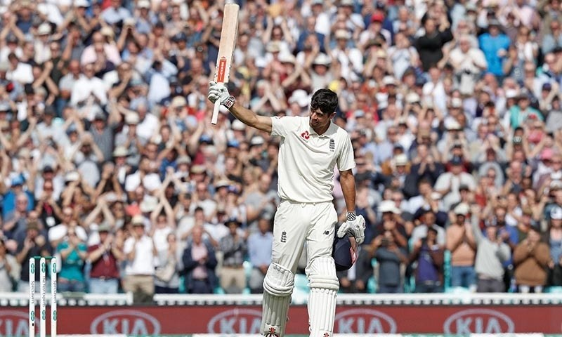 England's Alastair Cook celebrates his century during play on the fourth day of the fifth Test cricket match between England and India — AFP