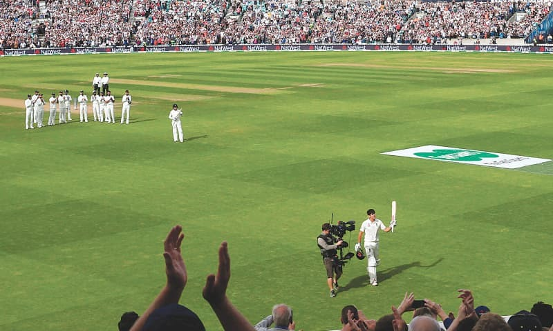 LONDON: England opener Alastair Cook walks off to a standing ovation after being dismissed during the fifth Test against India at the Oval on Monday.—Reuters