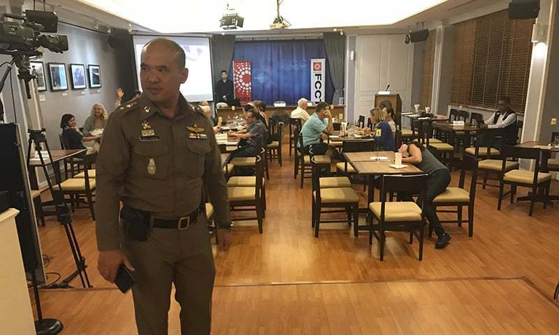 "In this Sept 6, 2018, photo, a Thai policeman stands inside Foreign Correspondents' Club of Thailand during an event titled: ""Will Myanmar's General Ever Face Justice for International Crimes"" in Bangkok, Thailand.  ─ AP"