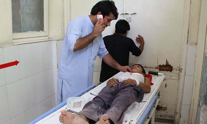 An Afghan wounded boy receives treatment at a hospital following multiple explosions in Jalalabad on Tuesday. — AFP