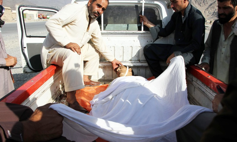 The body of a victim is transported in the back of a vehicle following a suicide attack in Mohmand Dara district of Nangarhar Province. —AFP