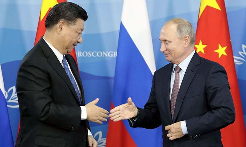 Russia's President Vladimir Putin (R) shakes hands with his China's counterpart Xi Jinping during a signing ceremony following the Russian-Chinese talks on the sidelines of the Eastern Economic Forum in Vladivostok. — AFP