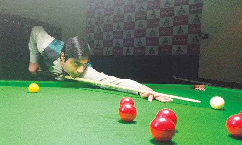 KARACHI: Haris Tahir in action during the third national ranking snooker championship on Tuesday.