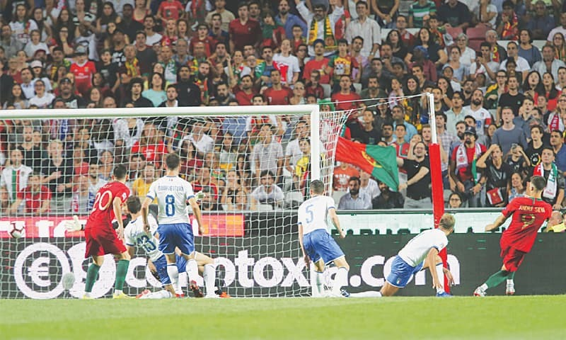 LISBON: Portugal's Andre Silva (R) scores the winner during the UEFA Nations League match against Italy at the Luz Stadium.—AP