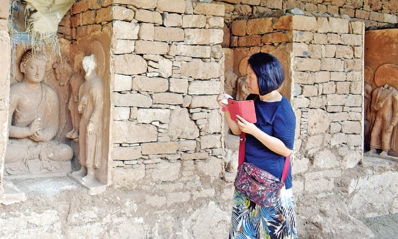 Dr Kyo Soon Park visits the Bhamala Buddhist Archaeological Complex in Taxila on Tuesday. — Dawn