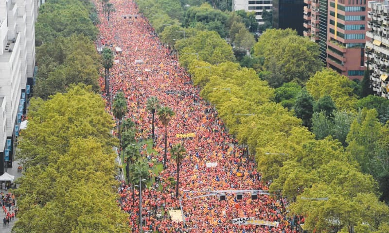 Barcelona: Demonstrators get ready for a demonstration in support of Catalonia's independence from Spain.—AFP
