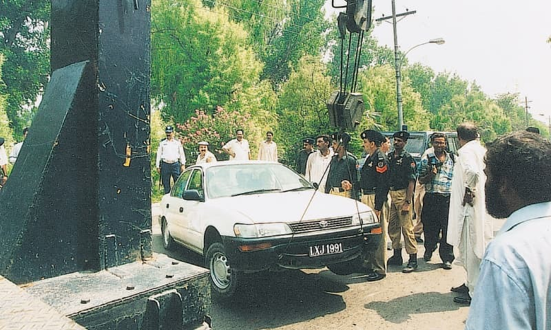 Kulsoom Nawaz Sharif's car being towed away with her in it. The former first lady, who had replaced her incarcerated husband as president of the PML-N days after the military coup, refused to leave the car. She locked it and made it known that she was going nowhere.—File photo by Azhar Jafri