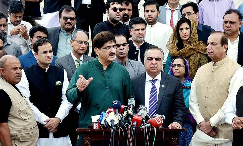 Sindh Chief Minister Syed Murad Ali Shah and Governor Sindh Imran Ismail talk to media persons at Mazar-i-Quaid. — APP