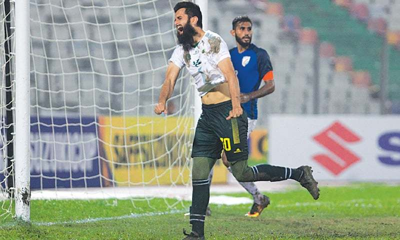 DHAKA: Pakistan's Hassan Bashir reacts after a missed chance during the SAFF Cup semi-final against India at the Bangabandhu National Stadium on Wednesday.—Courtesy SAFF