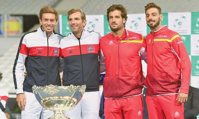(From L) FRENCH players Nicolas Mahut and Julien Benneteau and Spain's Feliciano Lopez and Marcel Granollers pose for photographers behind the Davis Cup in Villeneuve-d'Ascq on Thursday, after the draw for the Davis Cup semi-final. The two sides will compete for a place in the Cup final from September 14 to 16.—AP