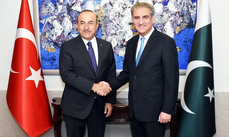 Foreign Minister Shah Mahmood Qureshi shakes hands with visiting Turkish counterpart Mevlut Cavusoglu in Islamabad. —AP