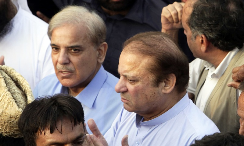Nawaz Sharif prays during a funeral of his wife Kulsoom Nawaz. —AP