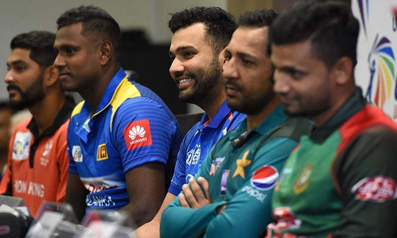 Indian cricket team captain Rohit Sharma (C) speaks during an Asia Cup press conference as Hong Kong cricket team captain Anshuman Rath (L), Sri Lankan cricket team captain Angelo Mathews (2L), Pakistan cricket captain Sarfraz Ahmed (2R) and Bangladesh cricket captain Mashrafe Mortaza (R) look on at the Dubai International Cricket Stadium in Dubai. —AFP