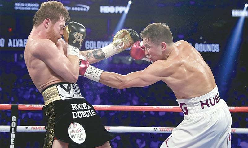 Canelo and GGG in action during the second of their two fights. — AFP