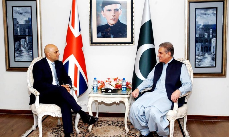 Foreign Minister Shah Mahmood Qureshi meets British Home Secretary Sajid Javid at the Foreign Ministry in Islamabad. —AP