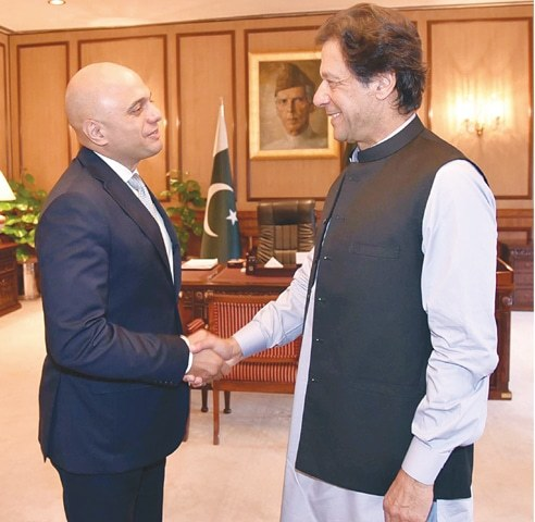 British Home Secretary Sajid Javid meets Prime Minister Imran Khan at PM office on Monday.—White Star