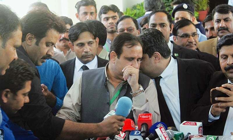 PUNJAB Chief Minister Usman Buzdar listens to an aide while talking to media outside the Supreme Court after hearing of the case pertaining to the transfer of former Pakpattan DPO.—Online