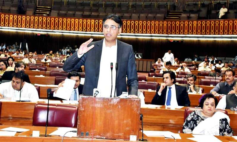 Finance Minister Asad Umar presents amendments to the budget for the ongoing fiscal year. —PID
