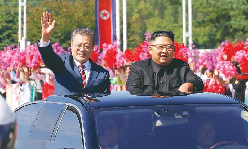 Pyongyang: North Korean leader Kim Jong Un (right) and South Korean President Moon Jae-in (left) wave to citizens as they drive through this city.—AFP