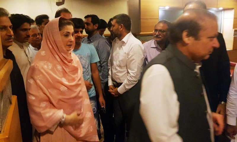 Maryam Nawaz and Nawaz Sharif at the airport after being released on bail. — DawnNewsTV/File